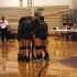 The girls huddle in excitement after a score.