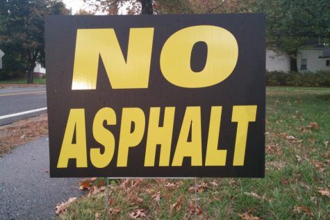 Disgruntled citizens rally as No Asphalt meeting is postponed