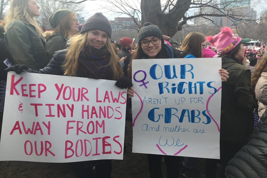 Two women at the Boston Women's Rights March protesting for their rights.