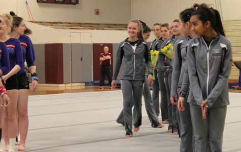 WA Gymnastics scores high but falls short of win on Senior Night
