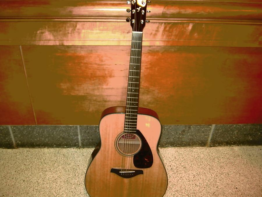 An acoustic guitar, which most of the songs contained as background noise during the Listening Lunch
