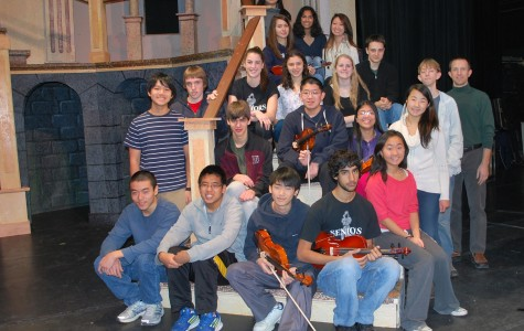Members of the Honors Orchestra prepare for their concert on Sunday