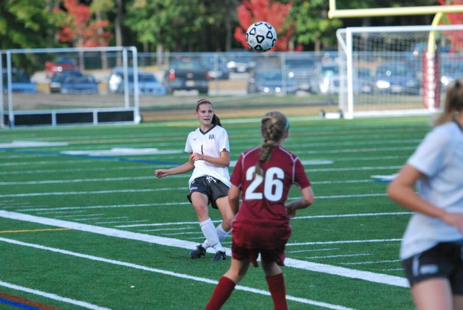 Senior Kyra Kruger chips the ball over a CCHS midfielder.