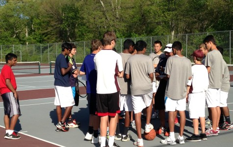 The team meets together after their loss to look forward to their next game and discuss what went wrong on the court.