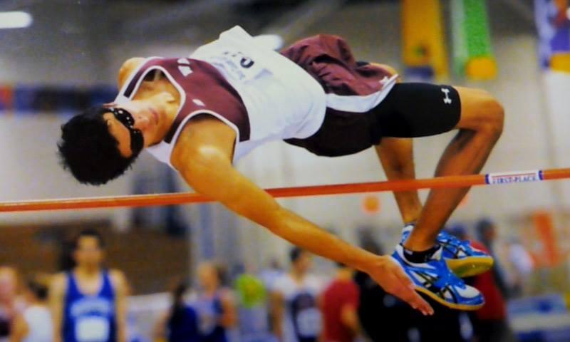 Qadir Barnard-Pratt jumping over the bar.