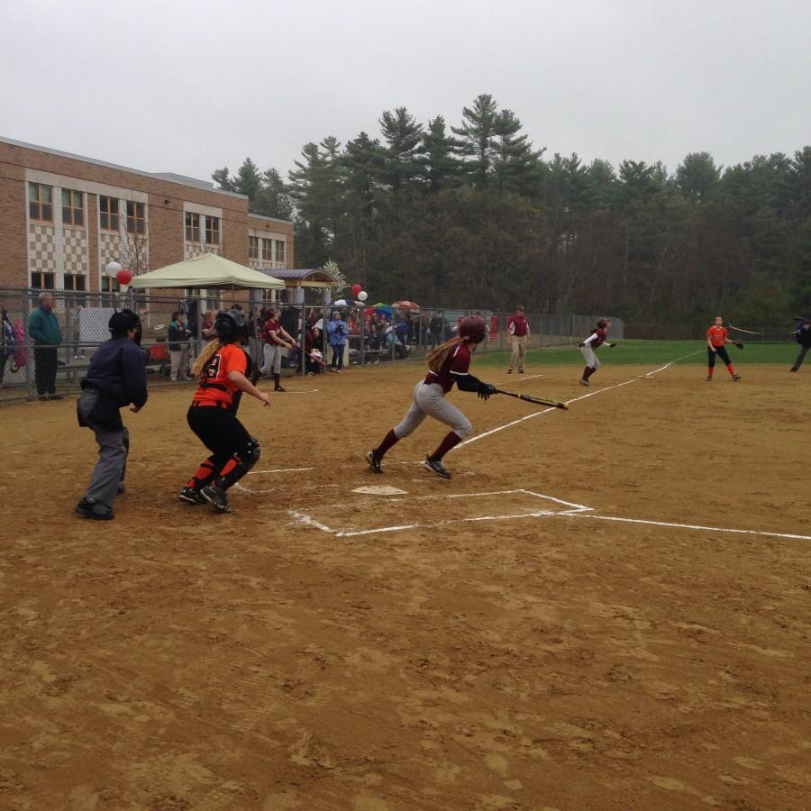 Ross begins the sprint to first base after a hit.