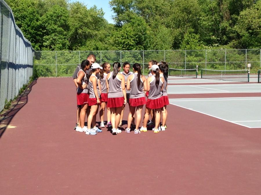 The team gets together before the match to discuss strategies.