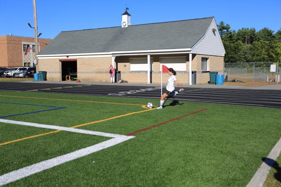 Molly Maclure hits a corner kick.