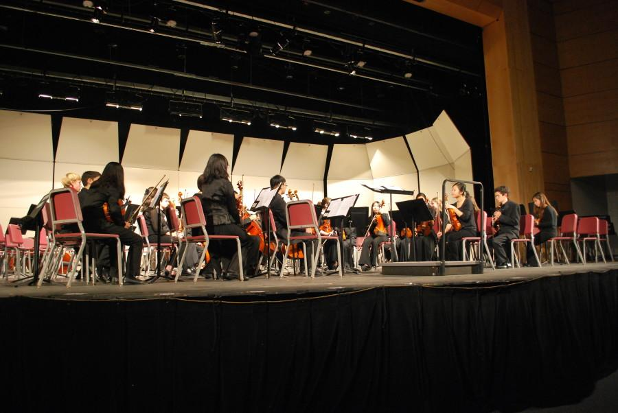 The orchestra prepares to play a piece.
