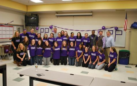 Herren poses with the Project Purple group.