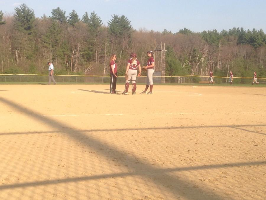 Catcher Kayleigh McHugh and pitcher Angela Alibrandi meet with an assistant coach.