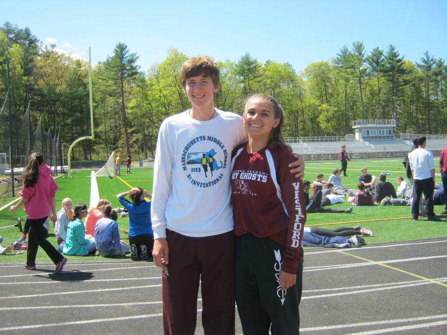 Dolan and Hall pose at track practice.
