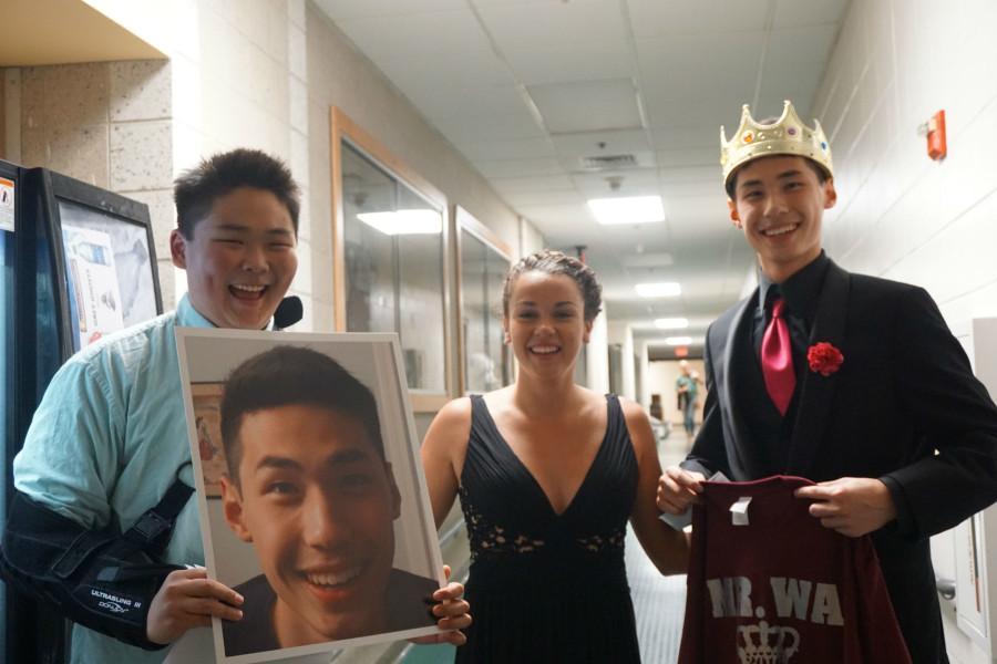 Winner, Stephen Wang with escort, Caroline Baggeroer and sophomore, Ian Kim