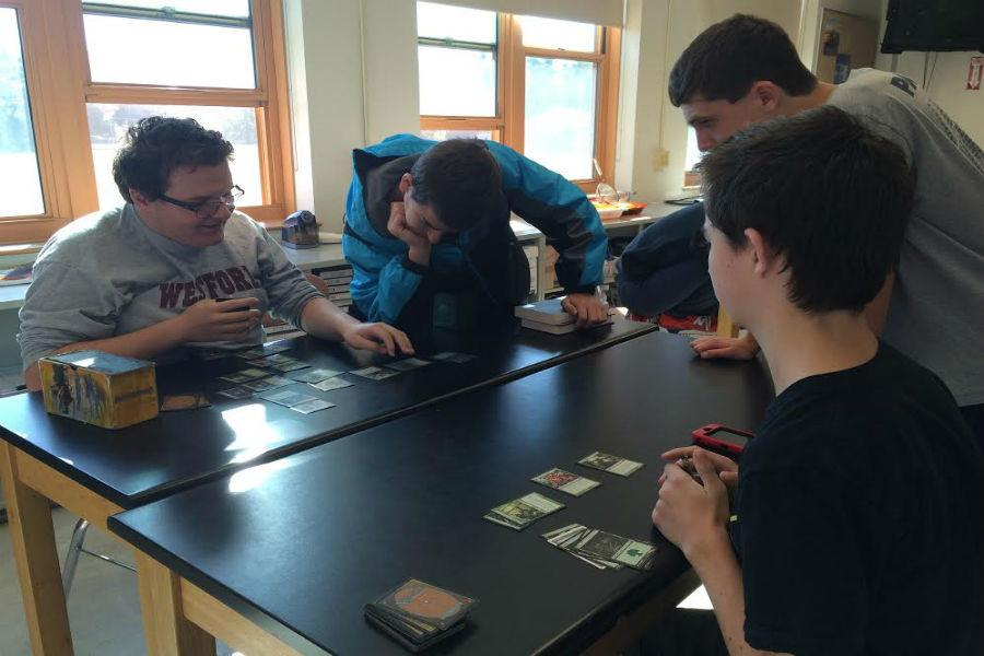 Members from game club playing a card game