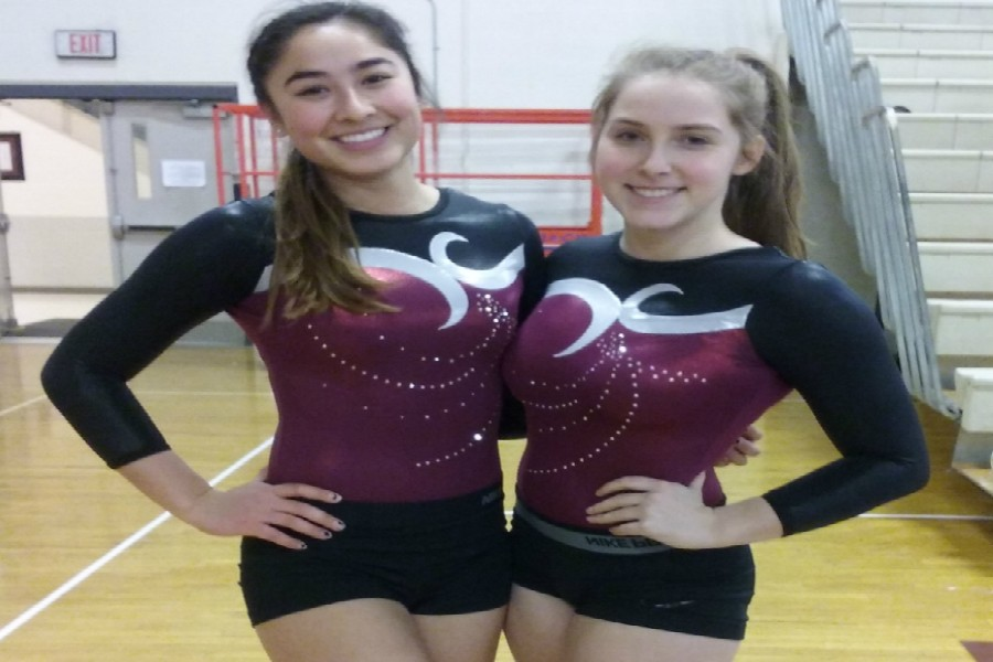 Senior Co-Captains Nikki Alipour and Jess Barry pose before gymnastics meet.