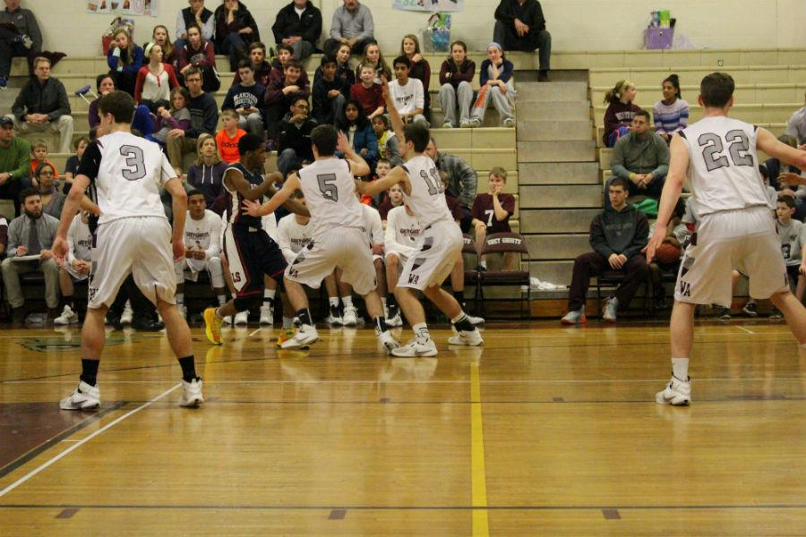 Seniors Nicholas Fiorillo, Pat Coffey, and Jonathan Glidden guard an LS player