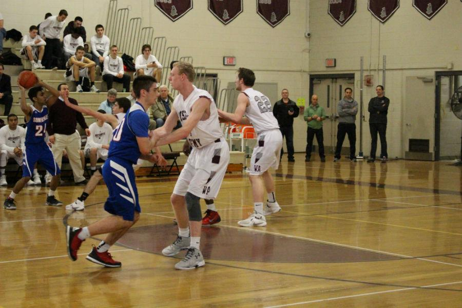 Senior+Jason+Hughes+and+Senior+Robert+Hartmann++preventing+Sommerville+players+from+getting+to+the+hoop