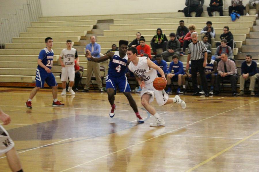 Junior+Eric+Jacobsen+makes+his+way+to+the+hoop