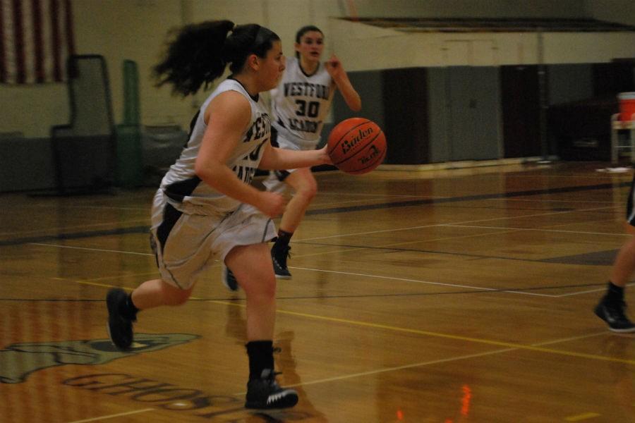 Junior Emily Bramanti running to take a shot.