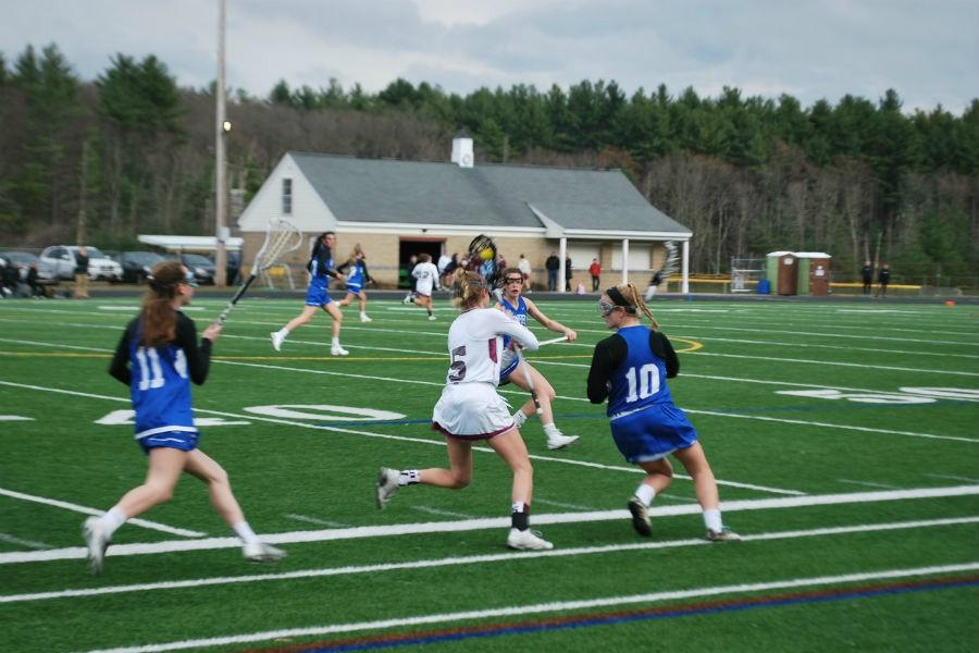 Senior Cat Mahanna defends herself against three Bromfield players.