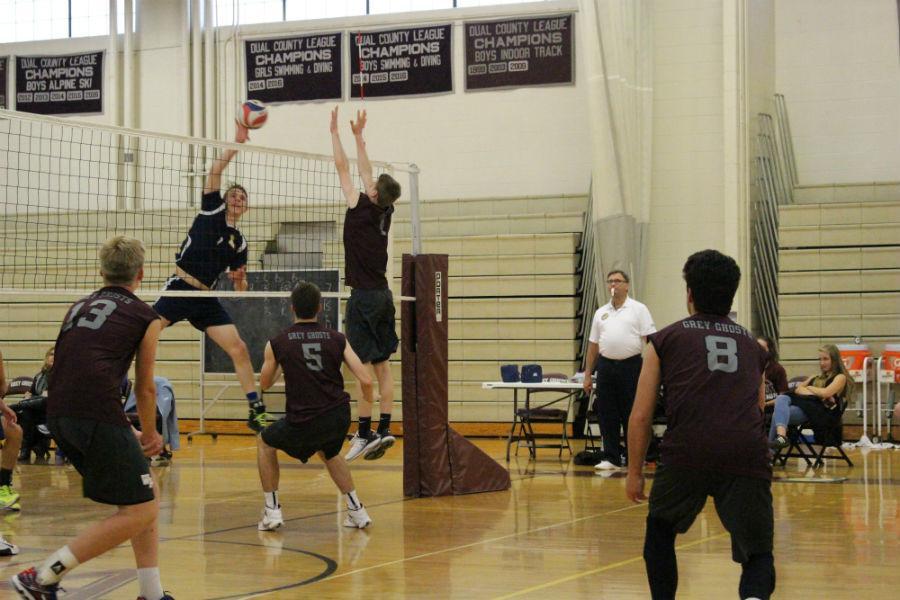 Senior+Brendan+Tierney+jumps+up+to+block+a+Lexington+player