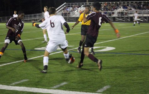 Senior Benjamin Pazienza tries to steal the ball from a Chelmsford player