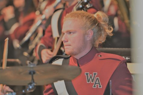 Senior Freddy Velasco performs on the drums for the marching band