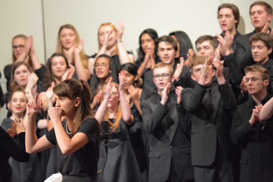 The chorus performs an eccentric for the audience