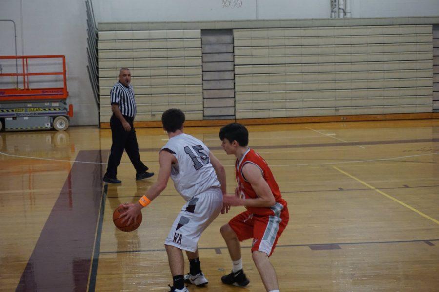 Senior Jonathon Glidden defending the ball.