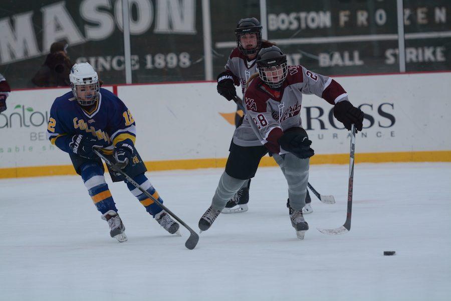 Senior+Colleen+Ellis+skates+off+with+the+puck%2C+resisting+AB+defense.