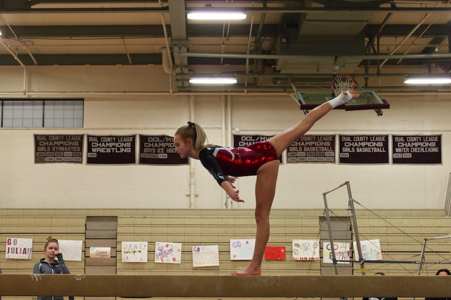 Freshman Olivia Donahue on beam