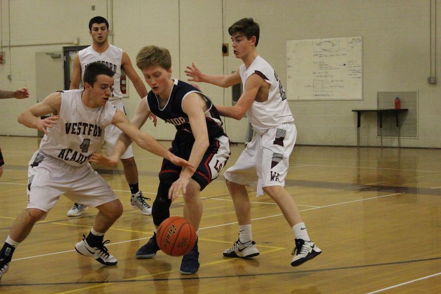 Sophomore Scott Beattie and Junior Paul Cran III guard an LS player