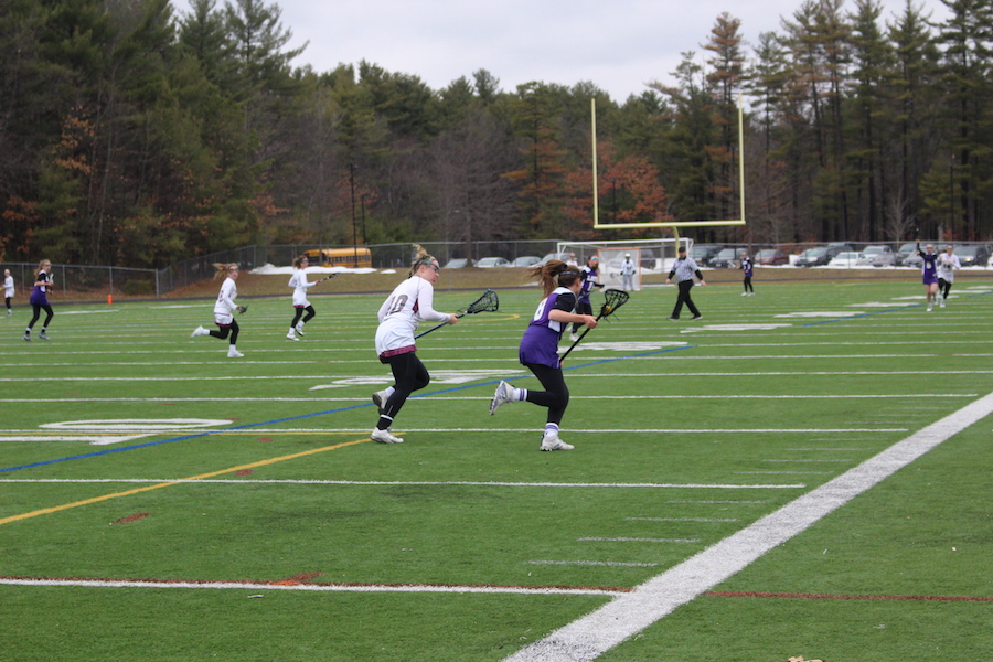 Senior McKenna Watson chases down a Boston -Latin player