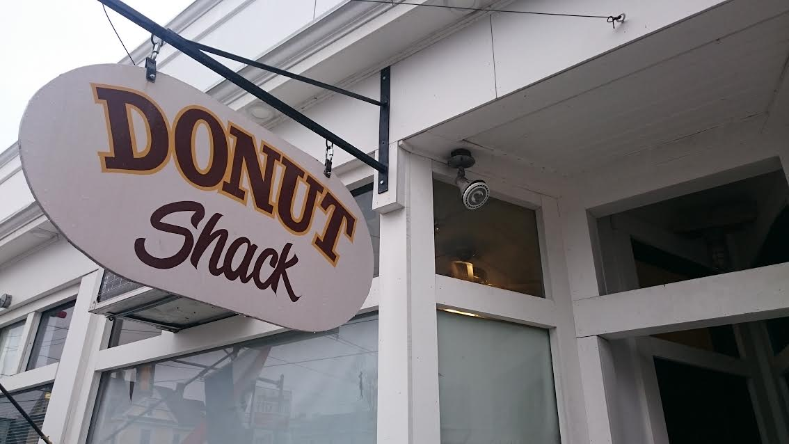 The Donut Shack sign in front of the shop.