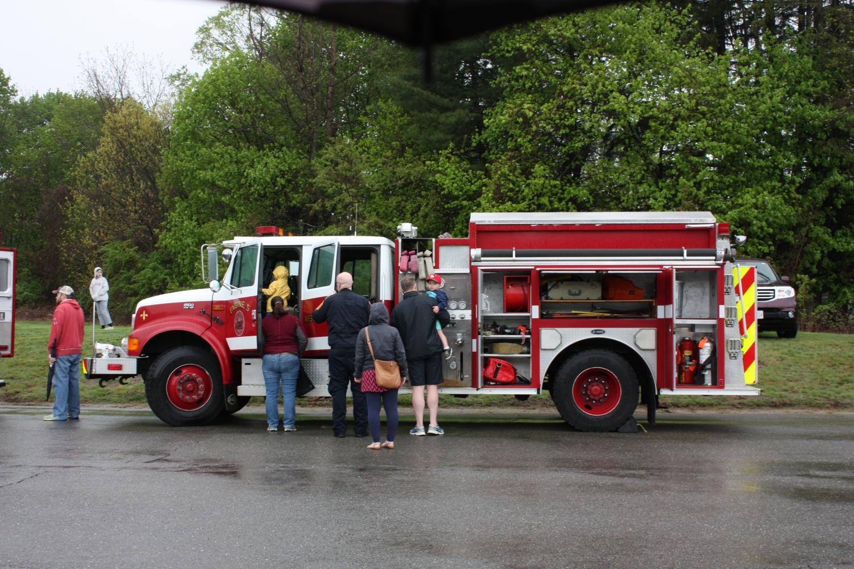Firefighter+showing+children+around+his+firetruck.