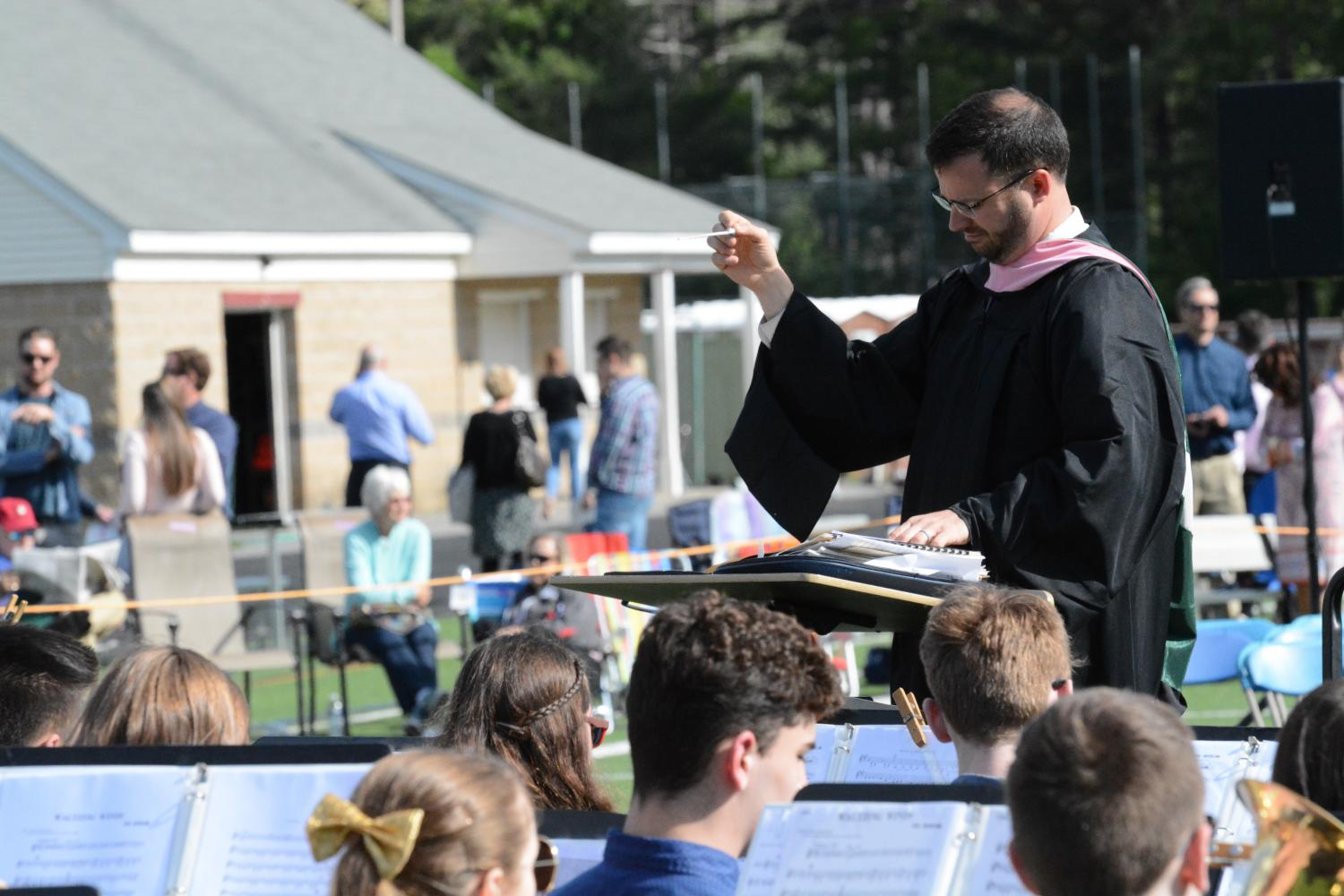 Music+teacher+George+Arsenault+composes+%22Pomp+of+Circumstance%22+while+the+WA+band+performs.