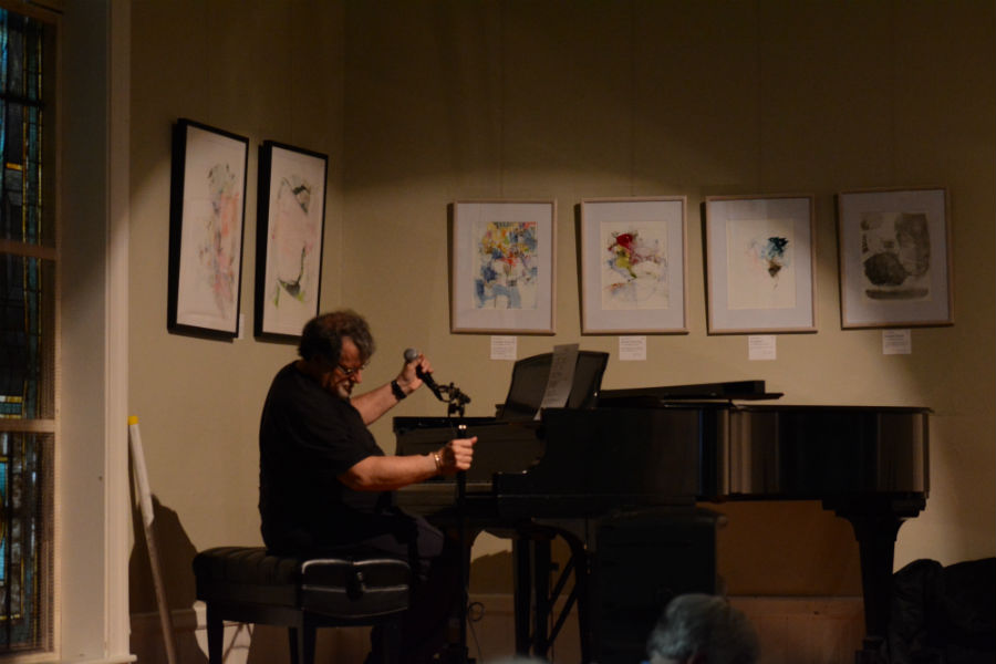 Mike+Santoro+performs+a+piece+on+the+piano