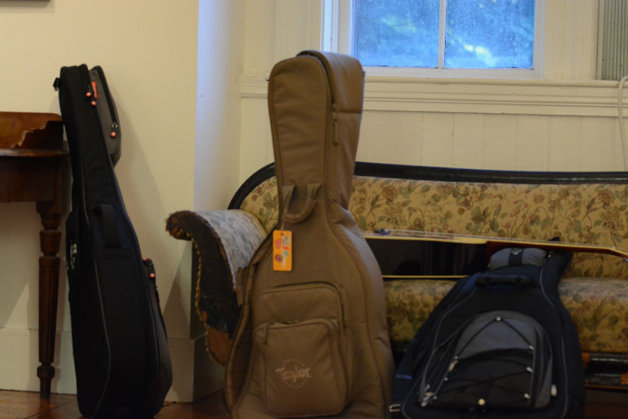 Guitar+cases+and+equipment+lie+in+the+room+next+to+the+hall