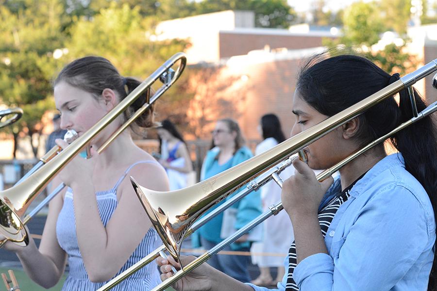 Freshman+Lasya+Dutta+plays+the+trombone+during+the+marching+band+performance.