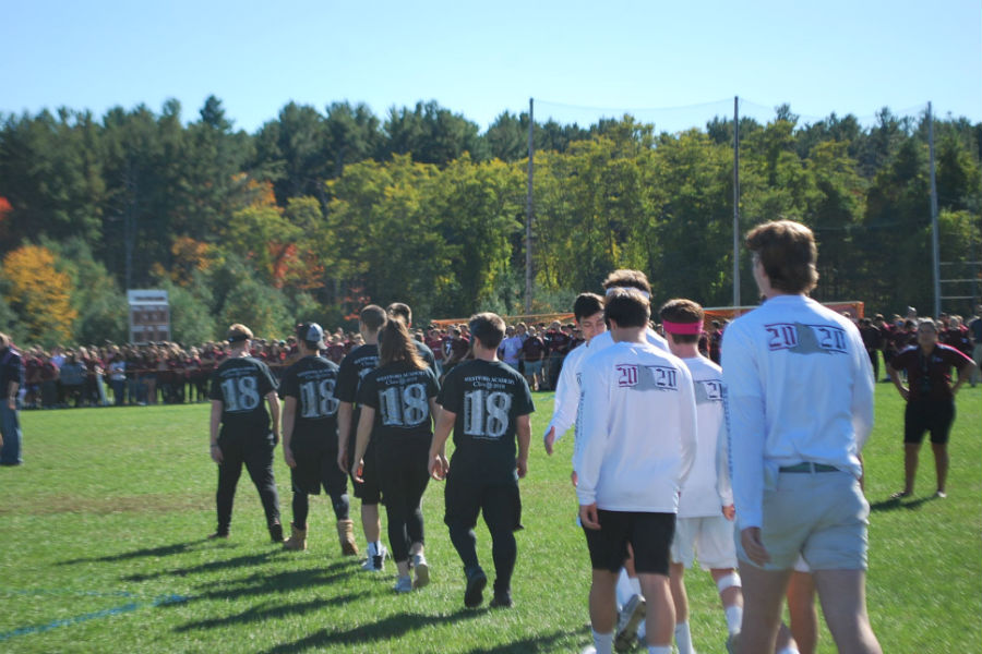 Senors+and+sophomores+competing+in+dodge+ball+walk+onto+the+field%0A