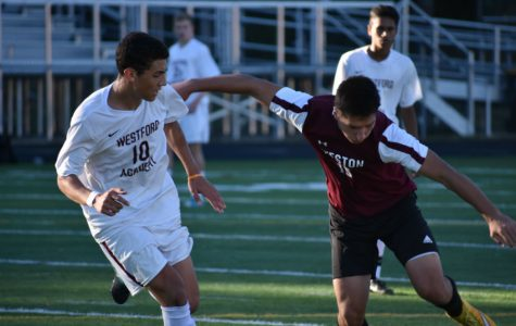 A player from Weston attempts to block Junior Nicholas Awada