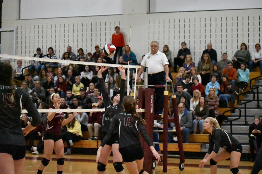 Senior Kayleigh Semeter sends the ball over the net