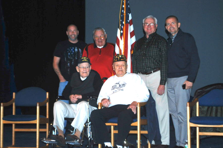 From left to right (above): Sergeant Thomas Sullivan, Yeoman 2nd Class Frank Harmon, Lieutenant Colonel David Sawyer, History Teacher Stephen Scully From left to right (below): Chief Warrant Officer Joseph McBreen, Corporal Joseph Landry