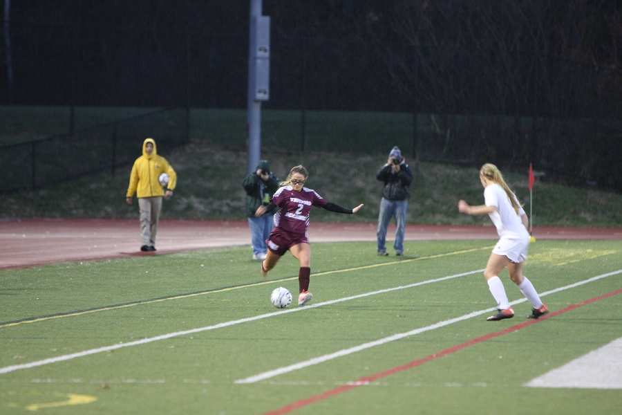 Senior Captain Rebecca D'Anna kicks the ball downfield.