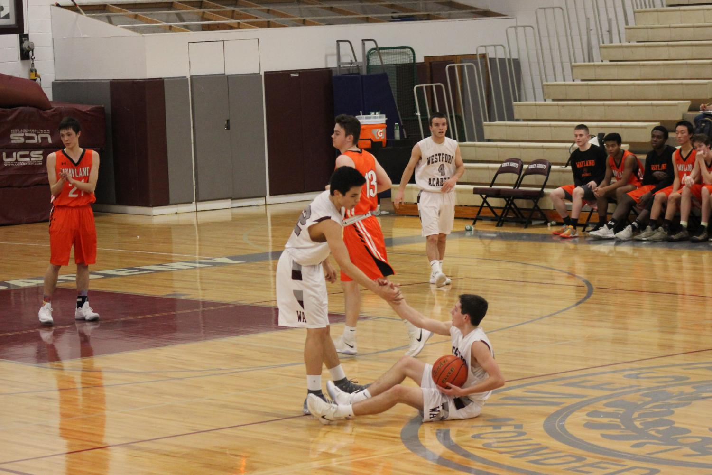 Sophomore+Declan+Morse+helps+up+a+fallen+teammate.+