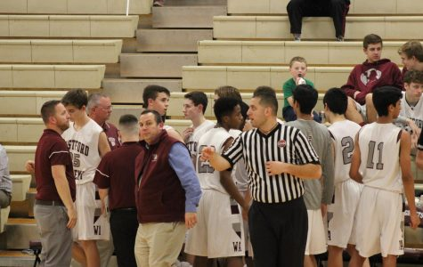 WA Boys' Varsity Basketball team gets first win of season