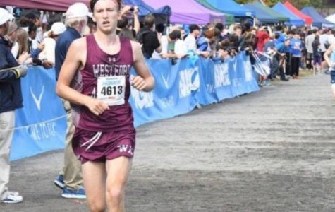 Dolan breaks two school running records