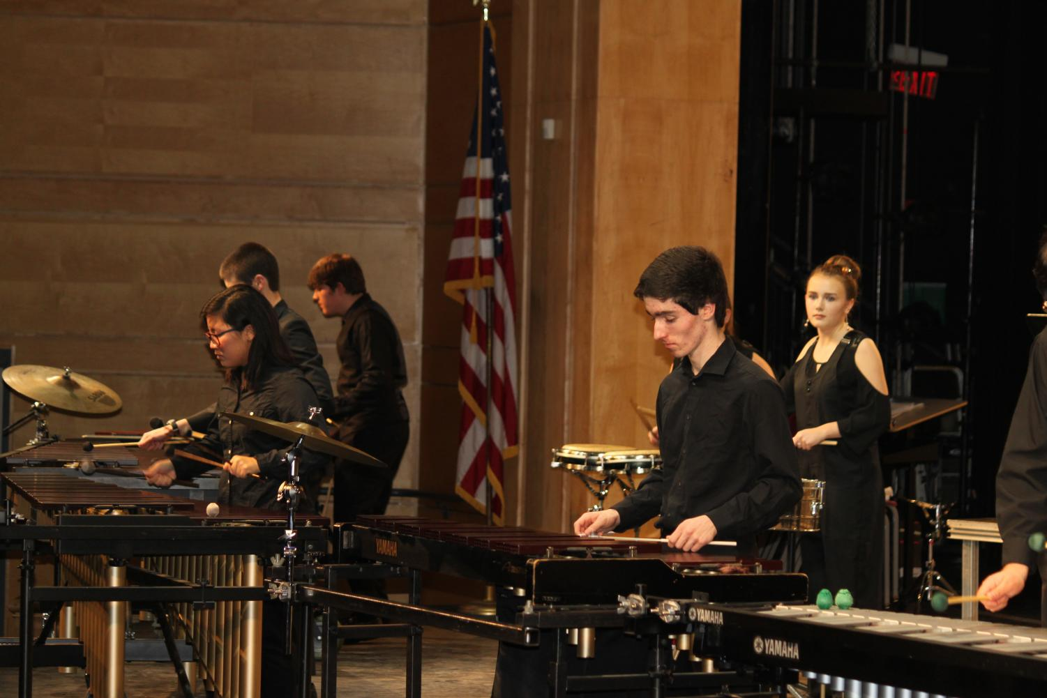 Juniors+Julianne+Lee%2C+Peter+Brown%2C+and+Kathryne+Lovell+of+the+Percussion+Ensemble+play+%27C.C.+Conga%27+by+Thomas+P.+Hannum.