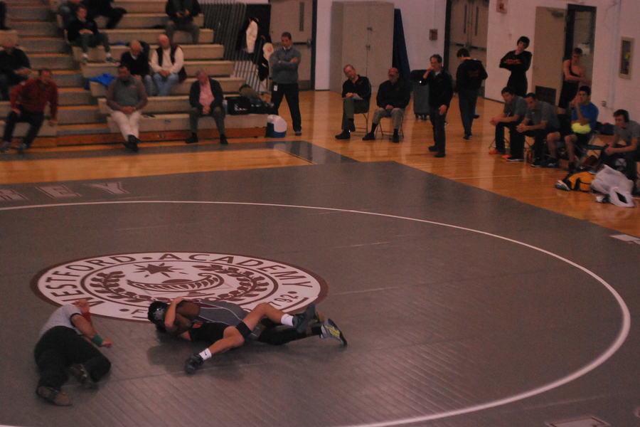 Sophmore+Ian+Njihia+pins+his+opponent.