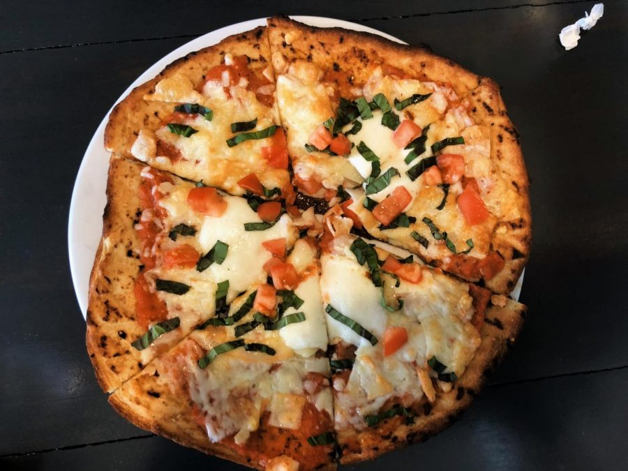 Fuse Bistro's thin crust pizza, with its signature house-pulled mozzarella cheese.